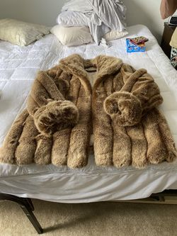 Donna Salyers (Fabulous Furs) Faux Furs Shaw Collar, 3/4 length, 16/18 sells new at $399.00. Worn only a couple times. Like new, immaculate condit Thumbnail