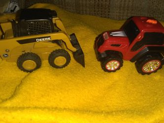 A John Deere mini front in loader & a road rippers tractor! Thumbnail