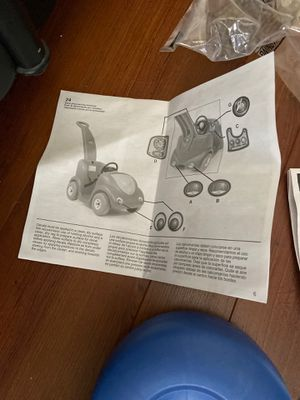 Photo Step 2 push buggy new with box Needs 3 wheels and you put together