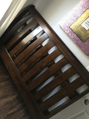 Beautiful queen wood headboard basically new. Comes with bed railing and side frames. for Sale in Lynchburg, VA