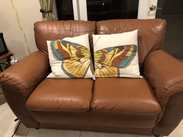 Italian Leather Sofa Bed and Love seat. With sofa decorated pillos ...