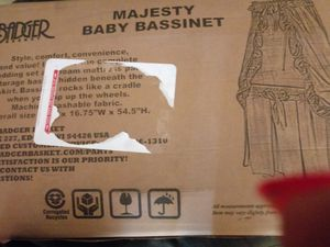 Brand new pink & white bassinet still in the box for Sale in Philadelphia, PA
