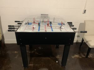 Photo Performance Games Bubble Hockey, bought new, rarely used.  The playing field is 32x38, comes with extra men, and batteries (4xAA).