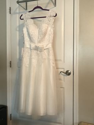 JJ's House, ivory wedding dress, size 8, standard fit, not altered, not worn. I bought two sizes, this one didn't fit. for Sale in Arlington, VA