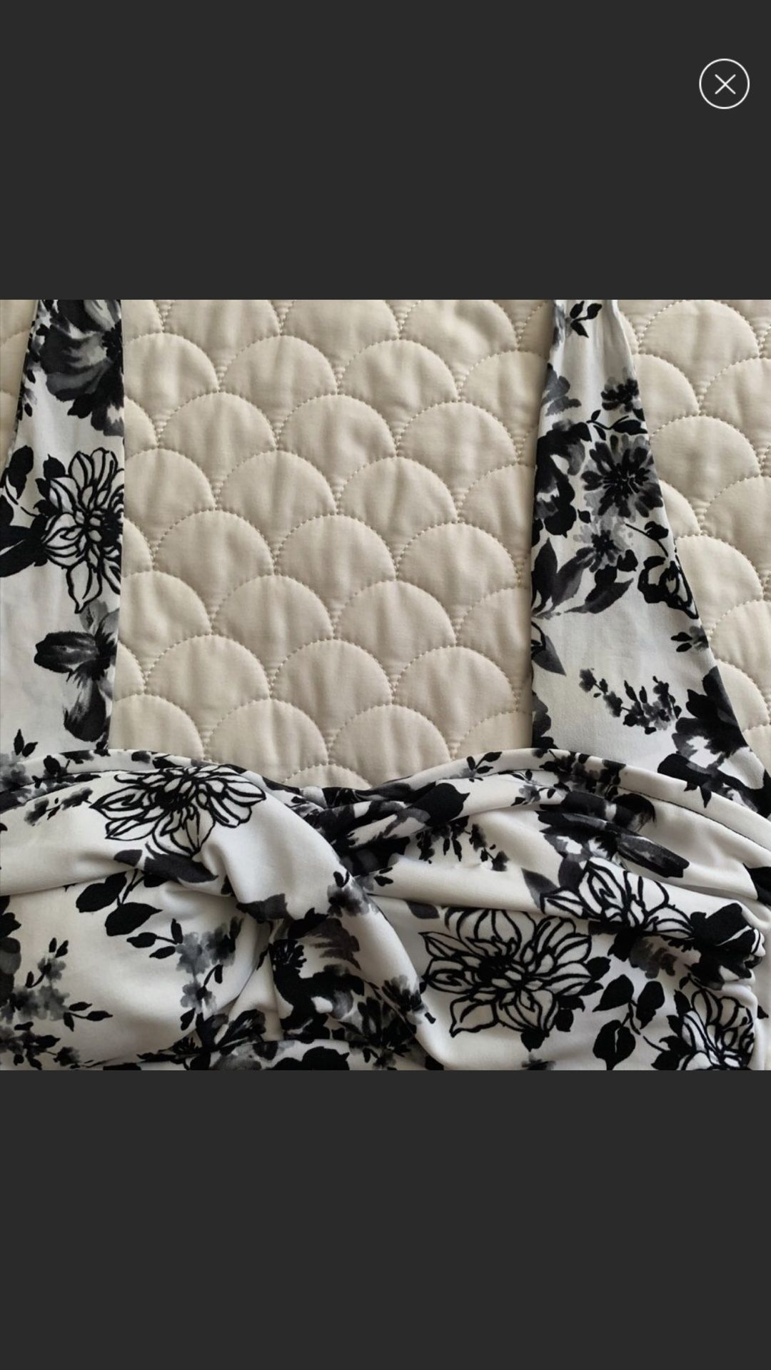 Two piece suit flowery white with black flowers very flattering by Catalina namebrand suddenly slim size medium New Like Condition