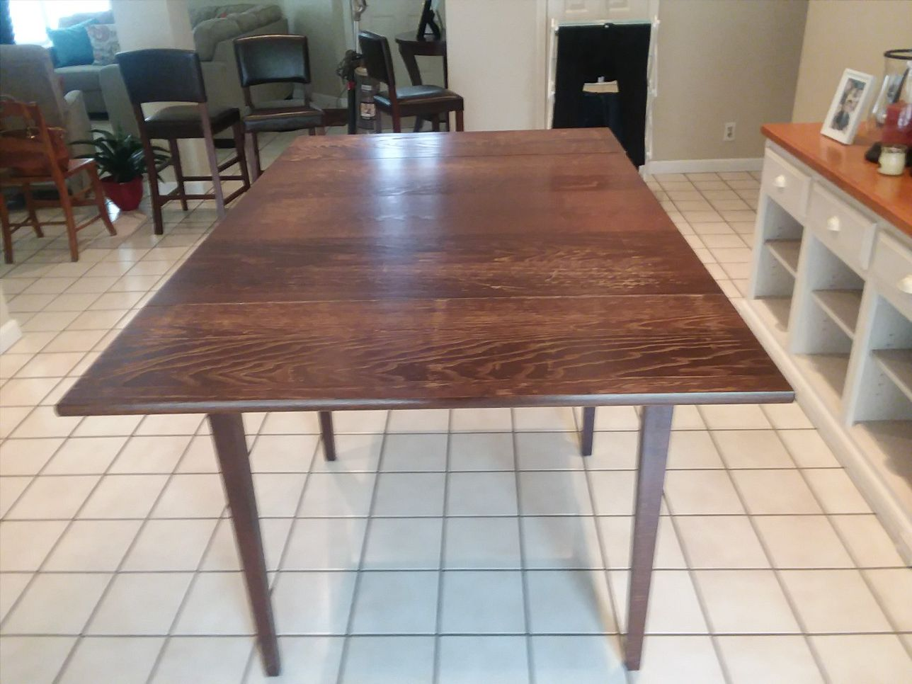 Pier One Pub Table. 3x3 extends to 5x3, height is 36. 10 years old, minor scratches.