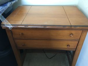 Sewing machine cabinet of maple. Machine shown is for illustration only. for Sale in Haymarket, VA