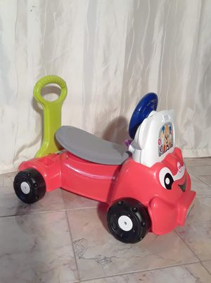 Photo Fisher price laugh and learn ride on