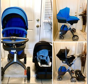 Photo STOKKE STROLLER WITH BASSINET & NUNA LITE CAR SEAT WITH BASE