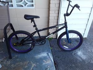 Photo 20 inch Mongoose trick bike