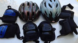 Two bicycle helmets and pads for knees and elbows for Sale in Apex, NC