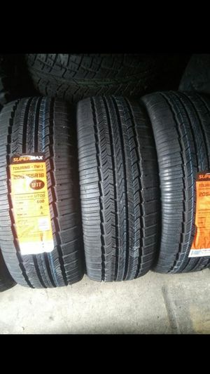 Photo BRAND NEW SET OF TIRES 205 55 16