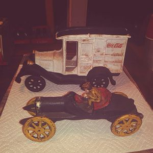 Photo Cast iron coke delivery and race car