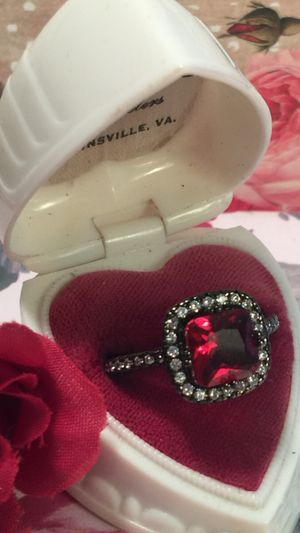 "Photo Ava's Steam punk "" halo set Ruby with pave set white sapphires on frame and on band of black gold size 10"