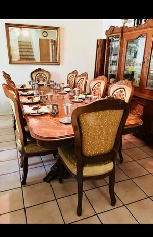 Photo Dining room table and china cabinet