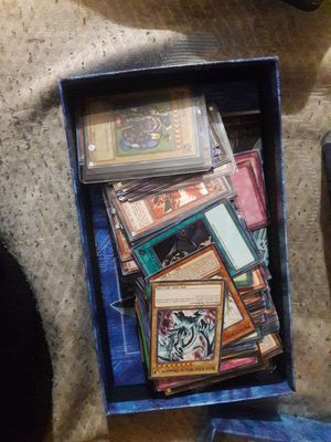 Yugioh 200 card lot plus game board for Sale in Houston, TX