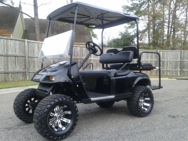 Lifted golf cart mudding