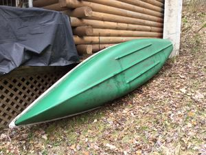 "Photo Canoe - Actually a Coleman ""Scanoe"". It has a flat transon in back that will accommodate a small HP outboard engine (5hp or less)"