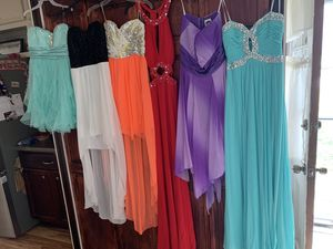 Photo Prom/formal dresses: Black size 12, Black and teal 11, light pink 14, Blue with tags 12, light tan 6, purple 14, long teal 8, red 5/6 orange 9, white