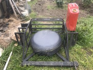 Photo Jeep spare tire and locking gas can holder dual