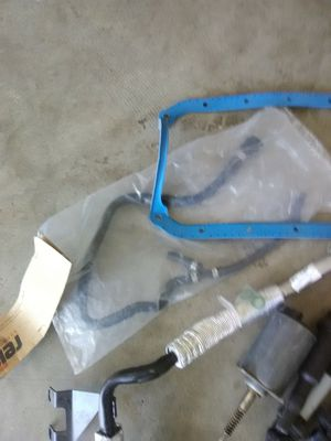 Photo 2003 and up 745i ignition coils oil pan gasket and other parts all brand new
