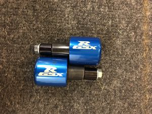 Anodized blue Suzuki handle bar ends for Sale in Waldorf, MD