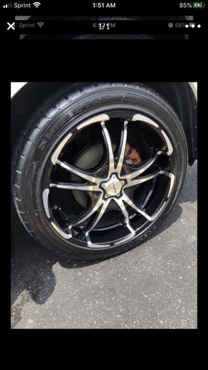 Photo 20 inch rims with good tires 5 lug universal . Price is FIRM $800