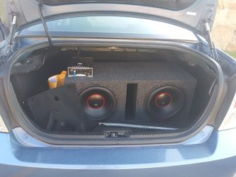 2009 ford fusion with two 12s DB Sub speakers and boss amp Thumbnail