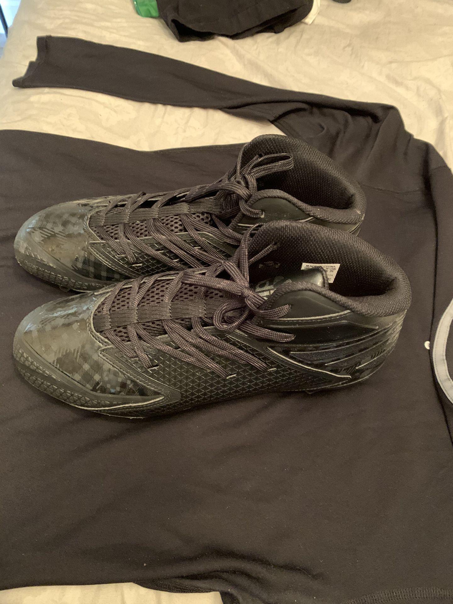 Adidas football or baseball cleats