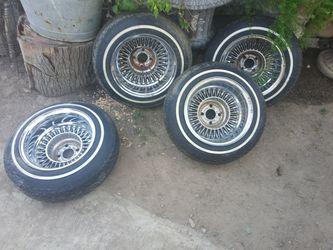 Set of Dayton spoke and tires good condition Thumbnail