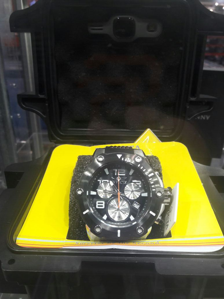 Men's Invicta Watch new in box retails for over 335.oo