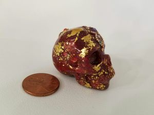 Blood orange and gold skull for Sale in Waldorf, MD