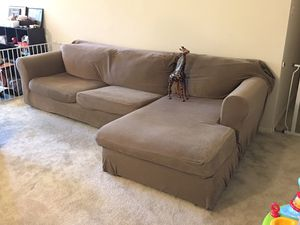 Two piece sectional couch with covers for Sale in Columbia, MD