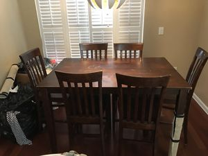 Wooden table with chairs for Sale in Kissimmee, FL