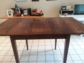 Pier One Pub Table. 3x3 extends to 5x3, height is 36. 10 years old, minor scratches. Thumbnail