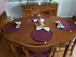 Beautiful circa 1940's dining room furniture. Table top refinished. Comes with 6 upholstered chairs, China cupboard, 2 leaves, table pads. for Sale in Frederick, MD