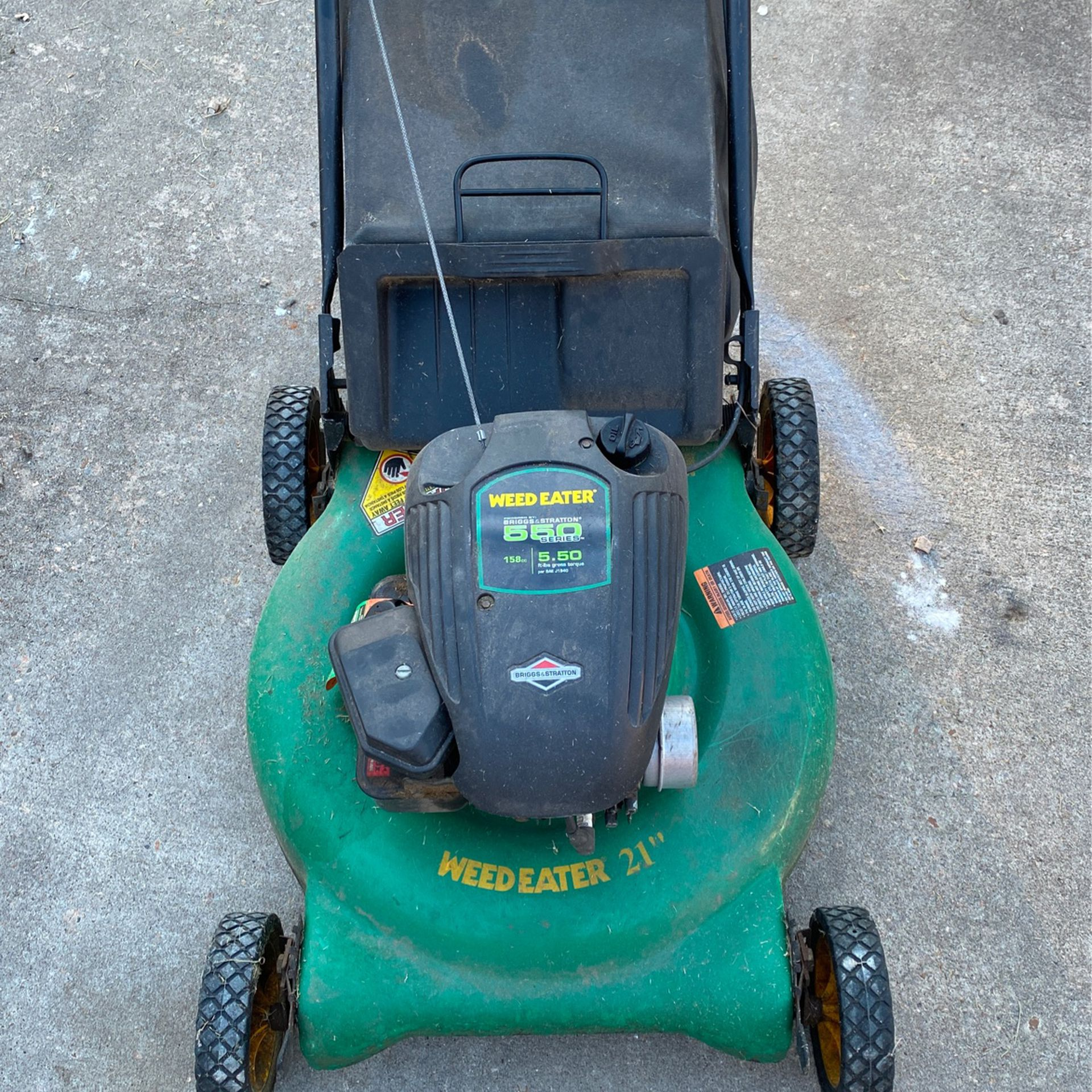 Two Running Lawn Mowers