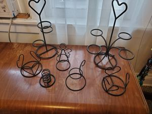 Photo Lot of candle holders, candle toppers and candles