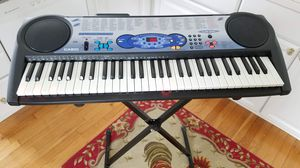 Photo Casio LK-40 Lighted 61 Key Portable keyboard With Stand