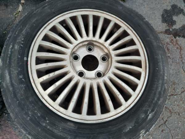 15 inch infiniti or Nissan aluminum wheels with old tires 5 on 114.3mm