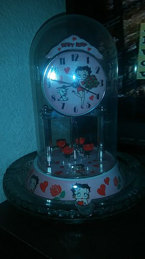 Betty boop spinning roses mini grandfather type clock for Sale in Las Vegas, NV