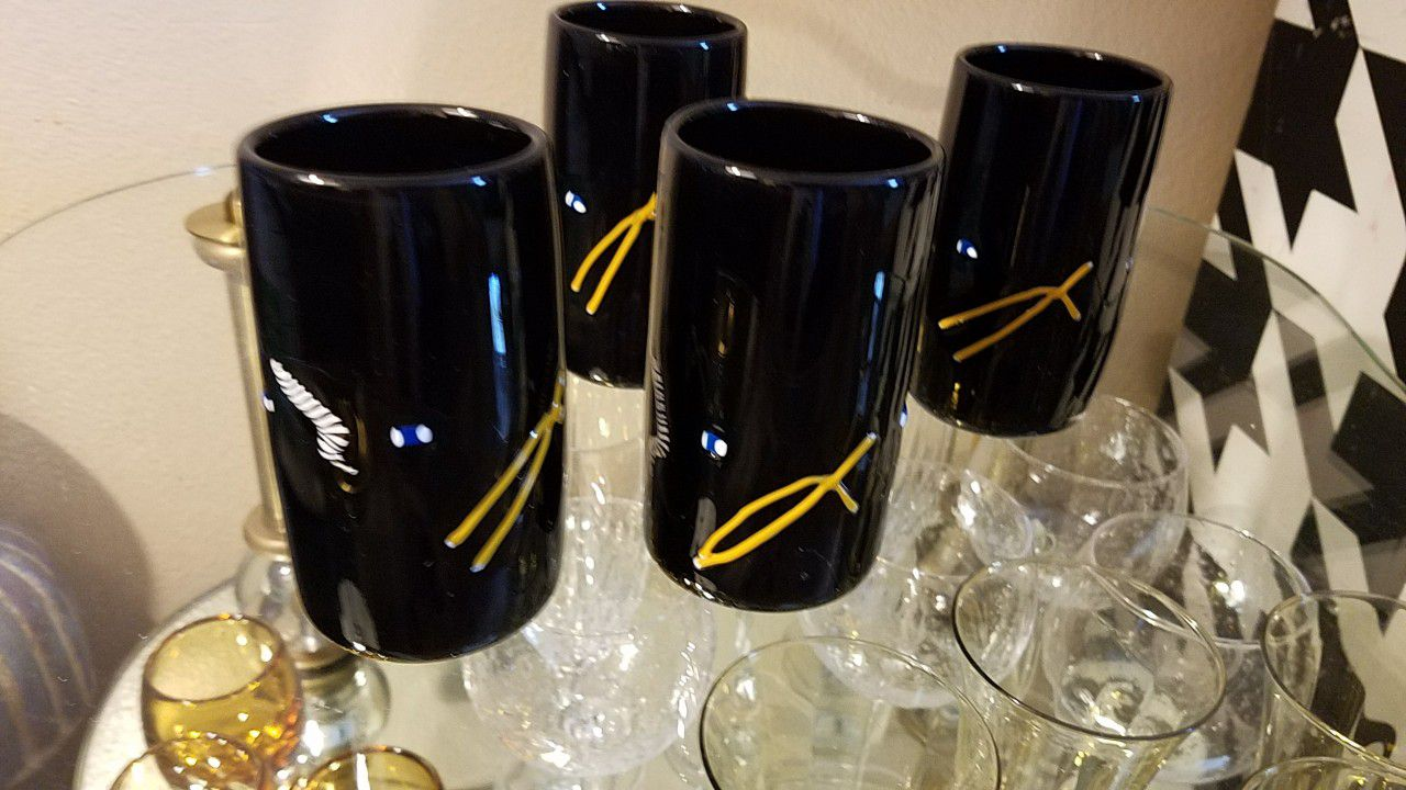 Four signed hand blown glasses