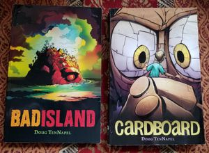2 GRAPHIX Books: BAD ISLAND & CARDBOARD for Sale in Mukilteo, WA