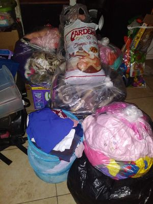 Clothing for kids and lady is all mix up also shoes and toys, books, backpacks for Sale in San Bernardino, CA