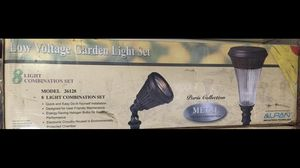 2 sets of brand new never used 8 low voltage garden lights for Sale in Potomac, MD
