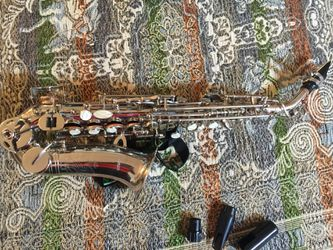 Very small baby soprano saxophone by Selmer in excellent condition. Thumbnail