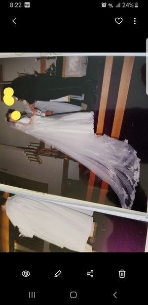 Photo Wedding dress, A-line, vail included that surpasses train on dress, size 2, hair clip and garter belt included.