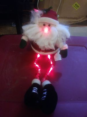 Avon holiday lighted leg sitters santa $5 for Sale in Sumas, WA