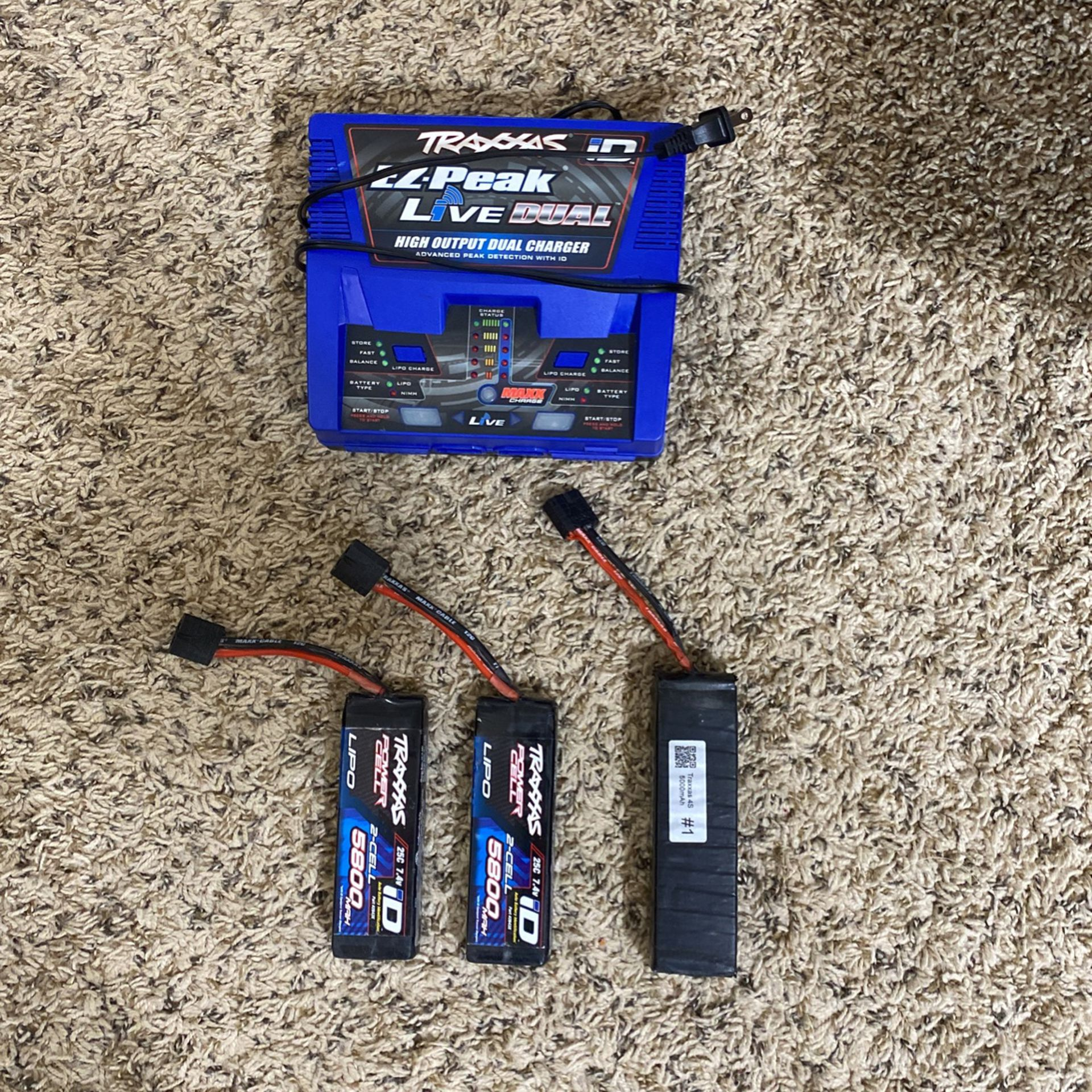 Traxxas Ez-Peak Live Dual charger and 2 2s 5800 MAH battery's and One 4s 5000 MAH battery