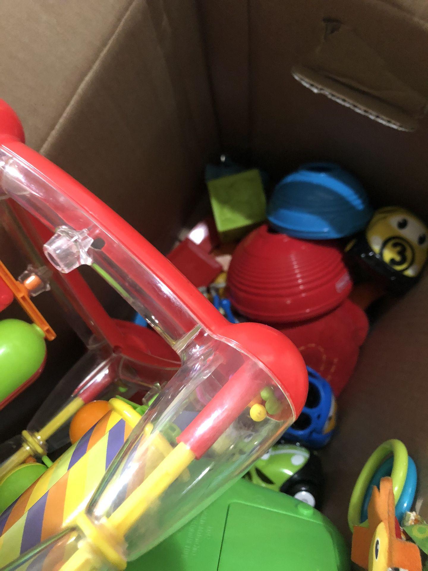 box of baby/toddler toys
